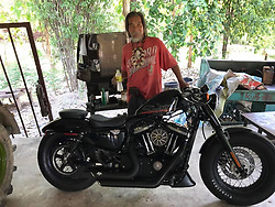 Shabbily dressed Thai man ignored by salespeople, ends up buying Harley-Davidson with cash..An elderly man in Thailand recently reinforced that value when he went around several motorcycle dealerships while dressed in a dirty oversized T-shirt, worn-out plain pants and slippers..Because of his attire, salespeople mostly ignored him and barely threw him a second glance, probably assuming that he would never be able to afford anything in their stores...The man went from one shop to another, until he arrived at one that treated him with warmth and hospitality...The man made up his mind within ten minutes and said, ''I'll have that one!''.Even more amazing was when he then took out 600,000 baht (around S$24,000) in cash and paid for the Harley-Davidson motorcycle right on the spot...The man has been identified as Lung Decha, an honest and diligient mechanic who has partially retired from work. He does not smoke, drink or gamble...Instead, after working hard for his whole life, he decided to use his savings to get his dream bike..©Maxsingburibike/Exclusivepix Media (Credit Image: © Exclusivepix media via ZUMA Press)