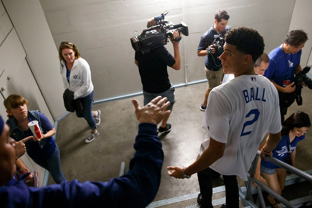 Lakers draft pick Lonzo Ball is recognized by a fan in the stairwell before throwing out the first pitch at Dodger Stadium on Friday, June 23, 2017 in El Segundo, California. The Lakers selected Lonzo Ball as the No. 2 overall NBA draft pick and is the son of LaVar Ball. © 2017 Patrick T. Fallon