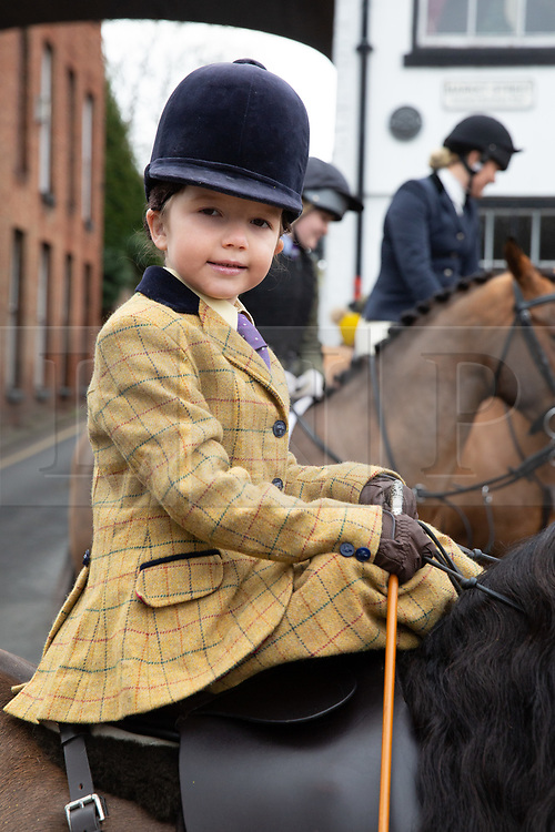 © Licensed to London News Pictures. 01/01/2019. Atherstone, North Warwickshire, UK. Pictured, Rose Cassapi (6) taking part in the Atherstone Hunt meet in the Market Square, Atherstone Town Centre, Warwickshire. The traditional New Year's Day Hunt starts at Noon with speeches and a drink for the Huntsmen and women. Riders of all ages took part in the meet and there were protests from Anti Hunt protestors who had positioned themselves in the centre of the Market Square. The Hunt then formed up and rode from the town centre passing huge New Year's Day crowds that had come to see the spectacle. Photo credit: Dave Warren/LNP