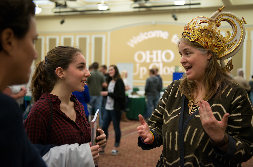 Nell Jacobson, a prospective student from New York speaks with respresentatives from the School of International Studies during the Ohio Up Close Resource Fair in Baker Ballroom.