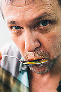 David Thopson tasting his Southern curry in Andy Ricker's kitchen, Chiang Mai
