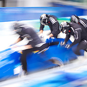 "Winter Olympics, Vancouver, 2010.A German Bobsligh team at the start during the Bobsleigh Four-man competition  at The Whistler Sliding Centre, Whistler, during the Vancouver Winter Olympics. 26th February 2010. Photo Tim Clayton.'BOB'..Images from the Four-man Bobsleigh Competition. Winter Olympics, Vancouver 2010..History was made at the Whistler Sliding Centre when the USA four-man bobsleigh team, led by Steven Holcomb took the Gold. The first time since 1948, a gap of 62 years, since the USA have won an Olympic Bobsleigh gold and they did it with their sleigh named ""Night Train""...The four days of practice and competition show the tension, nervousness and preparation as the teams of hardened men cope with the challenge of traveling at average speeds of over 150 km an hour. Indeed, five teams had already pulled out of the event before the opening heats because of track complexity, speed and fear, and on the final day, another four teams did not start after six crashes in the first two heats...Teams warm up behind the start complex, warming muscles in the cold in preparation for the explosive start. Many teams prepare in silence, mentally preparing themselves as they wait at the top of the run, in the bobsleigh sheds and the loading areas for their turn. When it's time to slide each team performs it's own starting ritual, followed by the much practiced start out of the blocks for just over four seconds, the teams are then in the hands of the accomplished drivers as they hurtle down the track for just over fifty seconds...Spectators clamber for the best position on track to see the sleighs for a split second, many unsuccessfully try to capture the moments on camera, The rumble of the sleigh is heard then the crowds gasp as it hurtles past in a blur...The American foursome of  Steven Holcomb, Justin Olsen, Steve Mesler and Curtis Tomasevicz finished with a pooled four-heat time of 3min 24.46sec. The German team led by Andre Lange won the Silver Medal in a combined t"