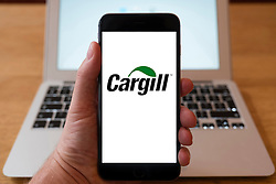 Using iPhone smartphone to display logo of Cargill , provider of food, agriculture and industrial products