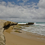 Rock formation and sand beach near the London Arch, along the Great Ocean Road.