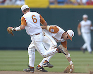 Texas shortstop Seth Johnston fields a ground ball hit up the middle as second basemen Robby Hudson (6) runs past Johnston.  Texas defeated Florida 6-2 for the National Championship at the College World Series at Rosenblatt Stadium in Omaha, Nebraska on June 26, 2005.