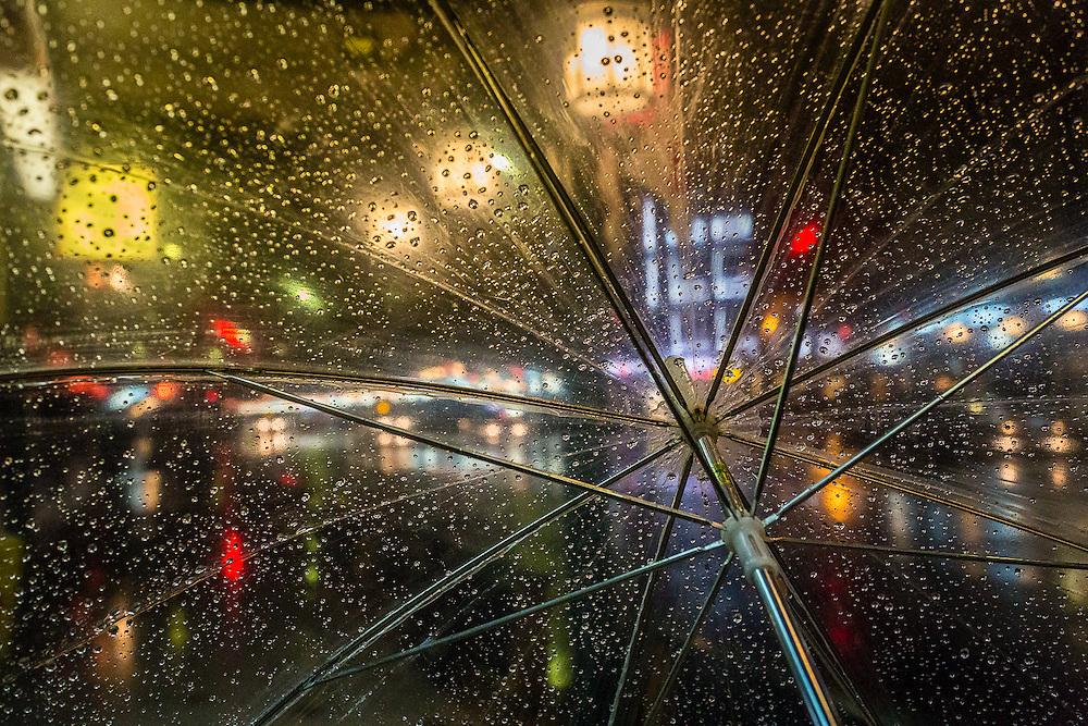 The lights of Gion, as seen through an umbrella.