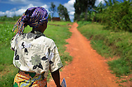 In northeast Rwanda, community health worker Marie Chantal walks  the footpath to her village, Batamuliza Hururiro. Marie attends to pregnant woman and mothers with new borns.