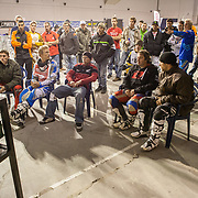 Under the Bercy stadium the riders watch practice and qualifiers.
