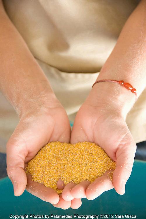 Ami Gignac shows off a handful of freshly milled organic polenta.
