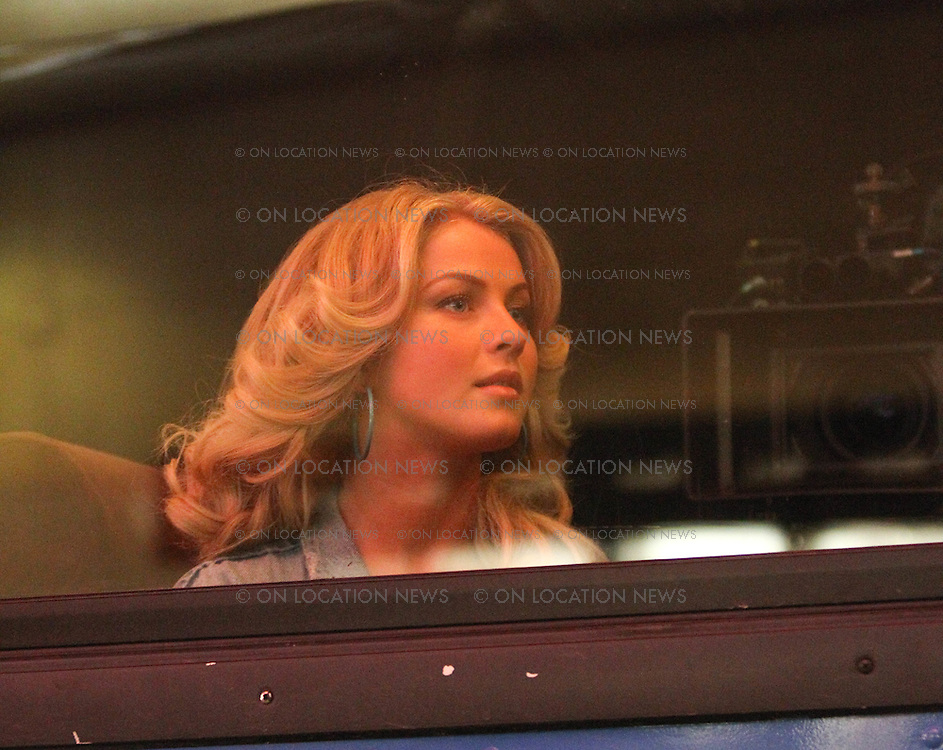 January 25th 2012 Hollywood, CA. ***EXCLUSIVE*** Julianne Hough on a Greyhound bus filming re-shoots for Rock of Ages. In this scene Julianne's character arrives in Hollywood on a bus from Oklahoma. Julianne peers out at the bright lights of Hollywood as her bus drives past various landmarks such as The Capitol Records building, The Chinese Theatre and Hollywood Blvd's Walk of Fame. Photo by Eric Ford/On Location News 1/818-613-3955 info@onlocationnews.com