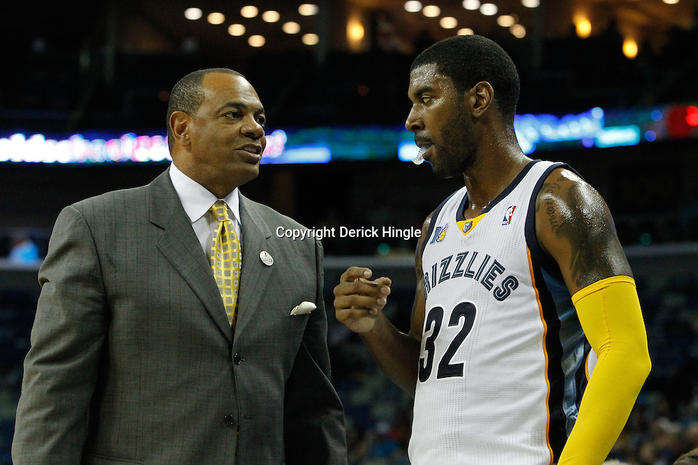 October 9, 2010; New Orleans, LA, USA; Memphis Grizzlies head coach Lionel Hollins talks to shooting guard O.J. Mayo (32) during the second half of a preseason game against the New Orleans Hornets at the New Orleans Arena.The Grizzlies defeated the Hornets 97-90. Mandatory Credit: Derick E. Hingle