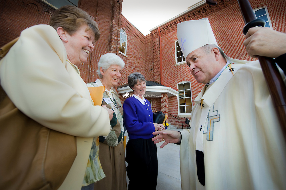 School Sisters of Notre Dame Sr. Kathy Schmittgens, Sr. Celine Schumacher and Sr. Mary Bryan Owens greeted Archbishop Robert J. Carlson after the celebration Mass. The SSND sisters renewed their vows during Mass and also celebrated their 150th anniversary in serving the parish.