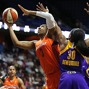 UNCASVILLE, CONNECTICUT- MAY 26:  Kelsey Bone #3 of the Connecticut Sun drives to the basket past Nneka Ogwumike #30 of the Los Angeles Sparks during the Los Angeles Sparks Vs Connecticut Sun, WNBA regular season game at Mohegan Sun Arena on May 26, 2016 in Uncasville, Connecticut. (Photo by Tim Clayton/Corbis via Getty Images)