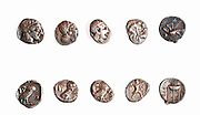 Ancient Greek coins 3rd - 4th century BCE. Left to right. 1. Athena 5th Century BCE. 2. Athena 4th Century BCE. 3. Athena 4th Century BCE. 4. Pamphilia Asoendos 385-370 BCE 5. Bruttium Kroton 350-300 BCE