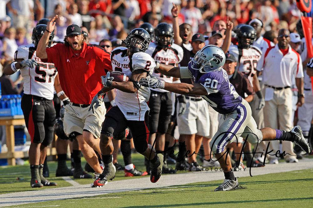 MANHATTAN, KS - OCTOBER 04:  Running back Shannon Woods #2 of the Texas Tech Red Raiders rushes down the sidelines in the first half past defensive back Courtney Herndon #20 of the Kansas State Wildcats on October 4, 2008 at Bill Snyder Family Stadium in Manhattan, Kansas.  Texas Tech won 58-28.