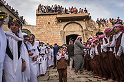 Young Yazidis gather outside the Holy Temple in Lalish during the Yazidi New Year celebrations in April 2018.