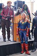 Garden City, NY, U.S. July 20, 2019. At right is SAMANTHA CATALANO as Captain Marvel, at left wearing red jacket is DOM CHARLAND as Peter Quill or Star-Lord, and upper right with red hair and green face is EYLIZA MORCIGLIO as Gamora - three Marvel super heroes in The NY Avengers non profit cosplay group, during Moon Fest Apollo at 50 Countdown Celebration at Cradle of Aviation Museum in Long Island at time Apollo 11 Lunar Module landed on Moon 50 years ago.