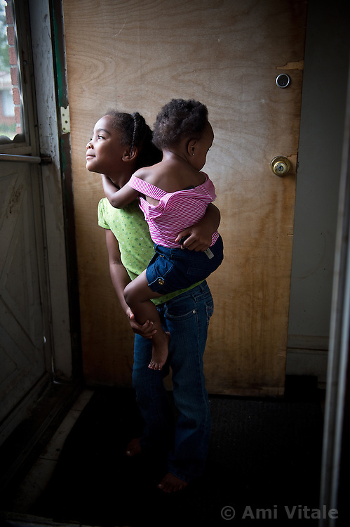 Siobhan Washington;s granddaughters La'Miya, 5 holds her cousin Mariyah McGhee's, 1. They both suffer from Asthma in River Rouge, Detroit, near a DTE coal plant August 13, 2012.