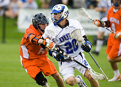 Duke midfielder Steve Schoeffel (20) avoids a check by Virginia attackman Ben Rubeor (6).  The #2 ranked Duke Blue Devils defeated the #3 ranked Virginia Cavaliers 11-9 in the finals of the Men's 2008 Atlantic Coast Conference tournament at the University of Virginia's Klockner Stadium in Charlottesville, VA on April 27, 2008.