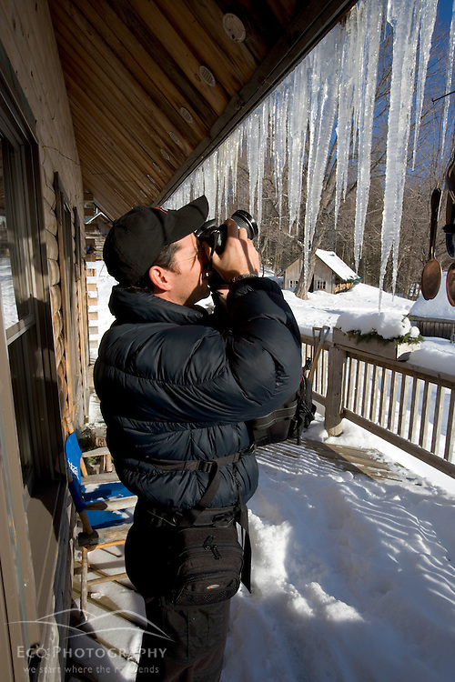 Photographing icicles at the AMC's Little Lyford Pond Camps in Maine's Northern Forest.  Near Greenville.