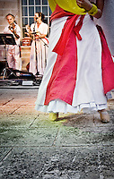"""Ballerina e musicisti del gruppo musicale di Pizzica """"Arakne Mediterranea"""" durante un concerto a """"Castello Monaci"""" nei pressi di Salice Salentino in provincia di Lecce. (30/05/2010 PH Gabriele Spedicato)..dancer and musicians of band """"Arakne Mediterranea"""" during the concert in """"Castello Monaci"""" near Salice Salentino, a Town in province of Lecce. (30/05/2010 PH Gabriele Spedicato)..La pizzica, o, detta nella sua forma più tradizionale pizzica pizzica, è una danza popolare attribuita oggi particolarmente al Salento, ma in realtà era praticata sino agli anni '70 del XX sec. in tutta la Puglia centro-meridionale e in Basilicata..Fa parte della grande famiglia delle tarantelle, come si usa chiamare quel variegato gruppo di danze diffuse dall'Età Moderna nell'Italia meridionale."""