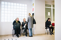 "NAPLES, ITALY - 9 NOVEMBER 2018: Unemployed citizens are seen here in line waiting to be served at the Eastern Naples Job Center in Naples, Italy, on November 9th 2018.<br /> <br /> Italy's 550 state-run job centers will be in charge of verifying that recipients of the ""citizens' wage"", a welfare policy championed by the governing 5-Star Movement designed to lift 5 million Italian out of poverty, meet an important eligibility criteria: that they are actively looking for a job.<br /> But Italians widely regard the centers as being blighted by obsolete technology and insufficient and under-qualified staff. The new populist government plans to spend 1 billion euros to modernize the centers — 10 percent of the total cost of the new policy in its first year in 2019. <br /> <br /> The ""citizens' wage"" will cost 10 billion euros next year, the most expensive item in a big-spending budget which itself has raised concerns in the European Union that Italy could be sowing the seeds of a financial crisis."