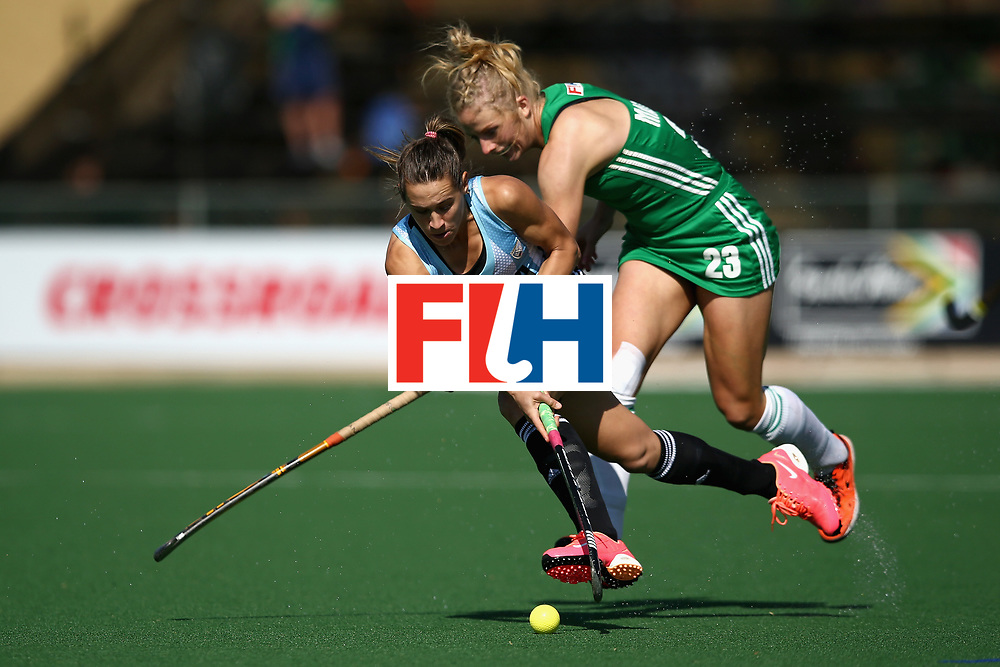 JOHANNESBURG, SOUTH AFRICA - JULY 18: Florencia Habif of Argentina and Hannah Matthews of Ireland battle for possession during the Quarter Final match between Argentina and Ireland during the FIH Hockey World League - Women's Semi Finals on July 18, 2017 in Johannesburg, South Africa.  (Photo by Jan Kruger/Getty Images for FIH)