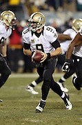New Orleans Saints quarterback Drew Brees (9) hands off the ball on a third quarter running play during the NFL NFC Wild Card football game against the Philadelphia Eagles on Saturday, Jan. 4, 2014 in Philadelphia. The Saints won the game 26-24. ©Paul Anthony Spinelli