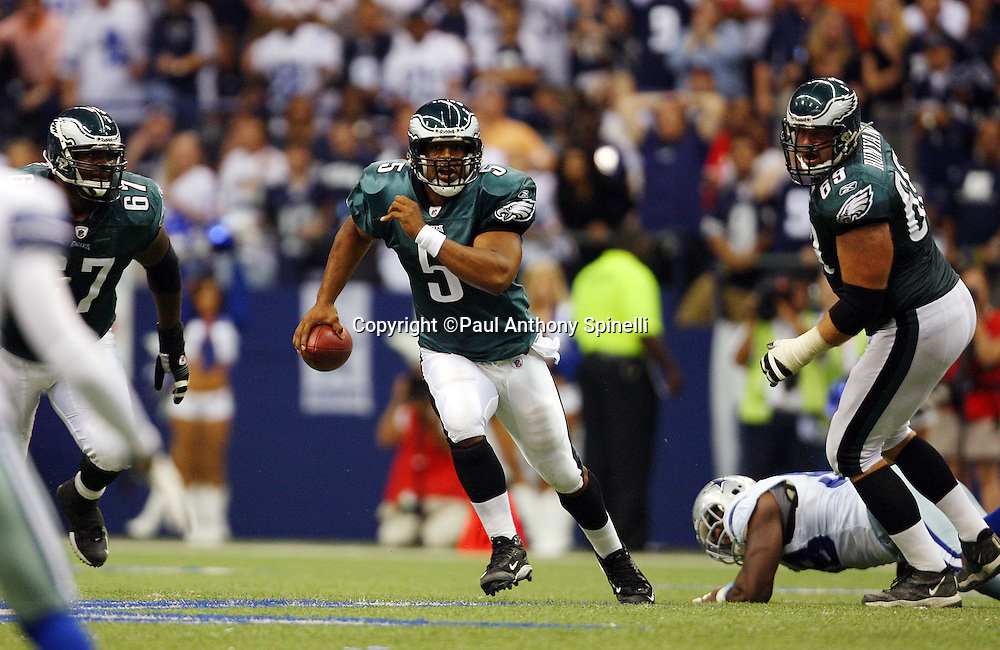 IRVING, TX - SEPTEMBER 15:  Quarterback Donovan McNabb #5 of the Philadelphia Eagles runs away from pressure while looking for a receiver during the game against the Dallas Cowboys at Texas Stadium on September 15, 2008 in Irving, Texas. The Cowboys defeated the Eagles 41-37. ©Paul Anthony Spinelli *** Local Caption *** Donovan McNabb