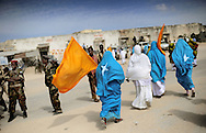 """Street images from the destroyed city of Mogadishu... Death or Play. Women´s Basketball in Mogadishu<br /> Women's basketball? In Europa and the U.S., we take it for granted. But consider this: In Mogadishu, war-torn capital of Somalia, young women risk their lives every time they show up to play.<br /> Suweys, the captain of the Somali women´s basketball team, and her friends play the sport of the deadly enemy, called America. This is why they are on the hit list of the killer commandos of Al Shabaab, a militant islamist group, that has recently formed an alliance with the terrorist group Al Qaeda and control large swathes of Somalia.<br /> <br /> Al Shabaab, who sets bombs under market stands, blows up cinemas, and stones women, has declared the female basketball players """"un-islamic"""". One of the proposed punishments is to saw off their right hands and left feet. Or simply: shoot them.<br /> <br /> Suweys´ team trains behind bullet-ridden walls, in the ruins of the failed city of Mogadishu – protected by heavily armed gun-men. The women live in constant fear of the islamist killer commandos. Stop playing basketball? Never, they say.<br /> Women´s basketball in the world´s most dangerous capital. Female basketball in Mogadishu, Somalia.<br /> A deadly game.."""
