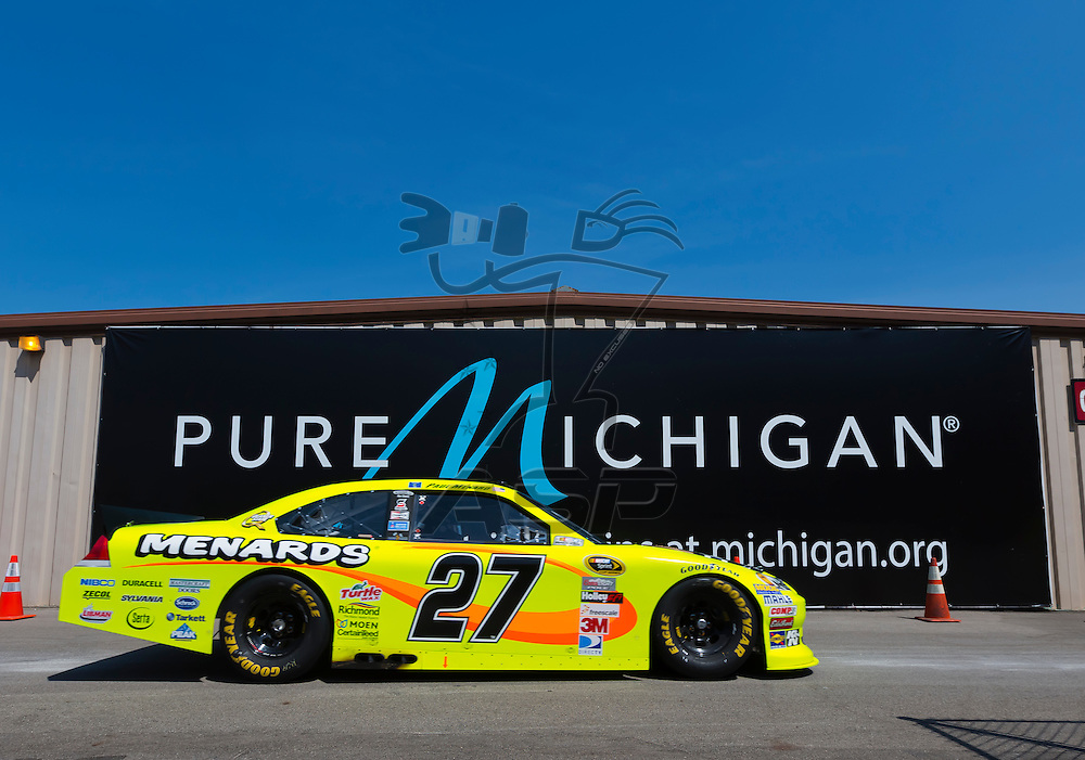 BROOKLYN, MI - JUN 15, 2012:  Paul Menard (27) brings his car back into the garage area during a practice for the Quicken Loans 400 at the Michigan International Speedway in Brooklyn, MI.