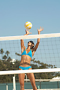 Young Woman with Flat Abs Playing Volleyball
