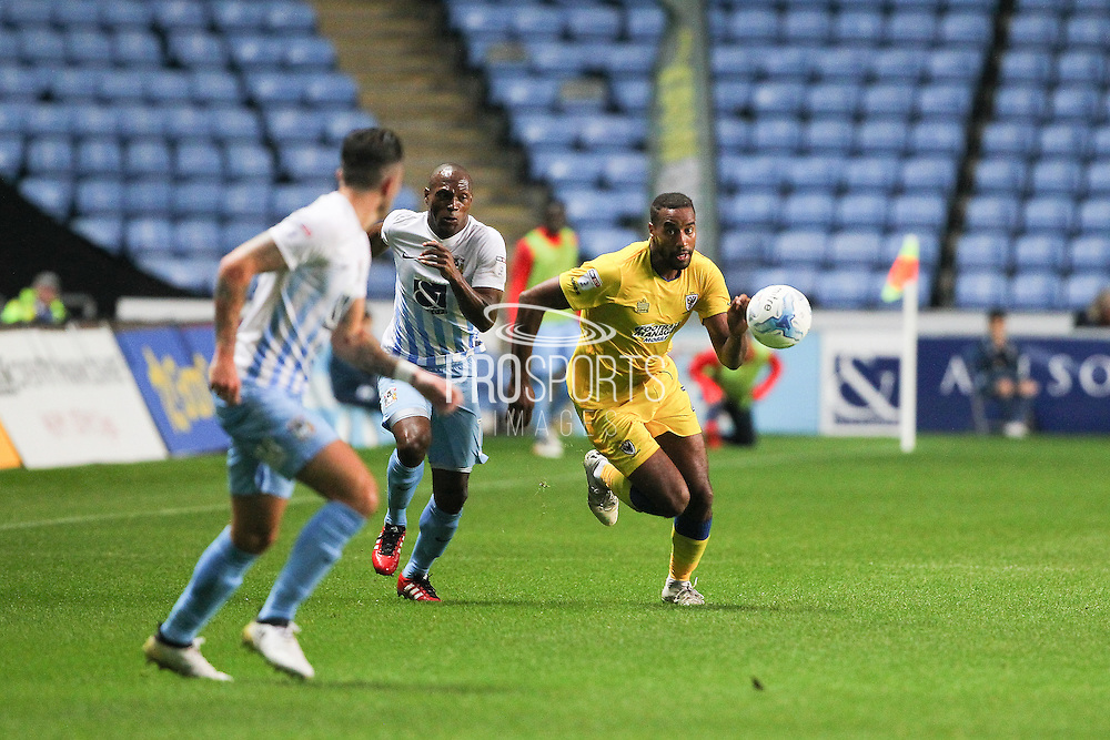 AFC Wimbledon striker Tyrone Barnett (23) and Coventry City midfielder Kyel Reid (11) give chase during the EFL Sky Bet League 1 match between Coventry City and AFC Wimbledon at the Ricoh Arena, Coventry, England on 28 September 2016. Photo by Stuart Butcher.