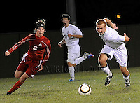 #21 Brennan Davis chases after the ball against a Kimberly player during their game at the Fondy soccer complex.Tuesday, September 11, 2012. Patrick Flood/The Reporter