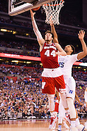 06 APR 2015:  Forward Frank Kaminsky (44) of the University of Wisconsin releases a layup in front of Center Jahlil Okafor (15) of Duke University during the championship game at the 2015 NCAA Men's DI Basketball Final Four in Indianapolis, IN. Duke defeated Wisconsin 68-63 to win the national title. Brett Wilhelm/NCAA Photos