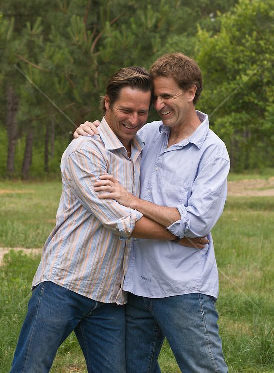 Gay Couple Sharing A Hug