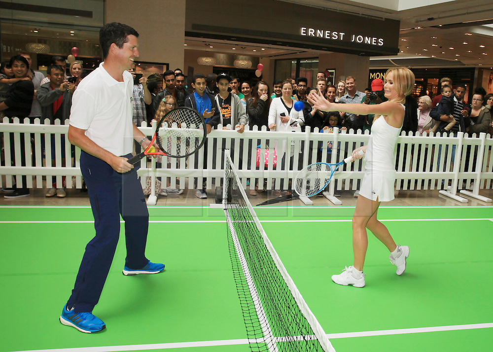 """©Licensed to London News Pictures. 07/06/2014. London, UK. """"Britain's Got Talent judge AMANDA HOLDEN takes on tennis with champion Tim Henman on the Robinson pop and play tennis court at Westfield Stratford City. Photo credit: LNP"""