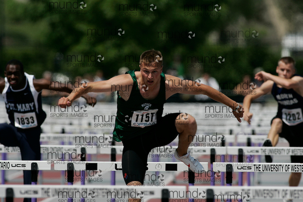 (London, Ontario}---04 June 2010) Greg MacNeill of Mother Teresa - London competing in the sprint hurdles at the 2010 OFSAA Ontario High School Track and Field Championships in London, Ontario, June 04, 2010 . Photograph copyright Sean Burges / Mundo Sport Images, 2010.
