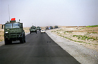 01 September 2005...The Kandahar-Kabul road has been completed in the recent years. Circa 500 Km of a long an fast lane of asphalt. ..In the picture armored vehicles travel towards Kandahar.