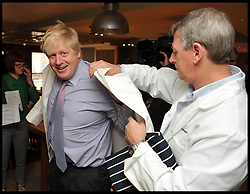London Mayor Boris Johnson  puts on his Chef whites as he launches Apprenticeship Week at the Premier Inn Leicester Square London, United Kingdom. Monday, 3rd March 2014. with Apprenticeship Hassan Abdul and Samantha Gattji. Picture by Andrew Parsons / i-Images