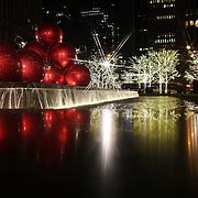 Christmas decorations on 6th Avenue, Manhattan, New York USA. 25th November 2012. Photo Tim Clayton