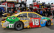 A tow truck brings in Kyle Busch's 18 car after a crash during practice for Sunday's NASCAR Sprint Cup race at Kansas Speedway in Kansas City, Kan., Friday, Oct. 4, 2013. (AP Photo/Colin E. Braley)