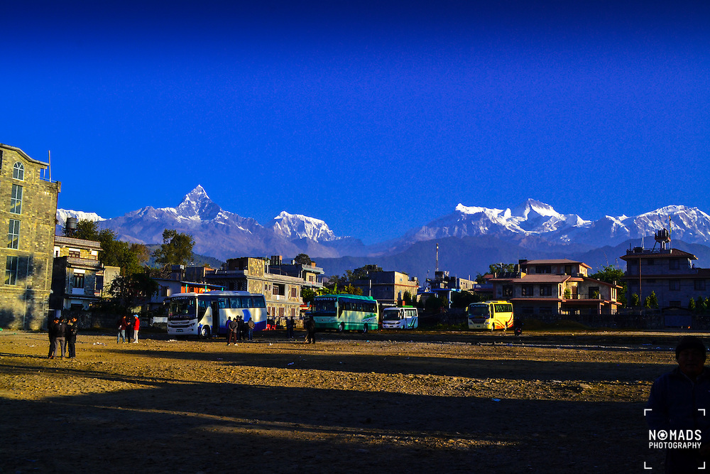 Shot from a bus depot in Pokhara, Nepal at dawn. The Annapurna mountain range can be seen in the background.