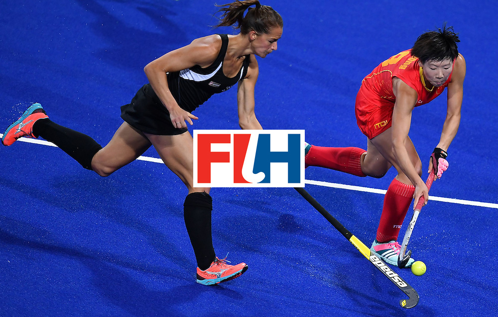 New Zealand's Petrea Webster (L) China's Wu Qiong  vie during the women's field hockey China vs New Zealand match of the Rio 2016 Olympics Games at the Olympic Hockey Centre in Rio de Janeiro on August, 13 2016. / AFP / MANAN VATSYAYANA        (Photo credit should read MANAN VATSYAYANA/AFP/Getty Images)