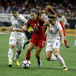 Oct 19, 2017; New Orleans, LA, USA; USA forward Christen Press (23) works against Korea Republic Cho Sohyun (8) and Lee Eunmi (2) during the second half of an International Friendly Women's Soccer match at the Mercedes-Benz Superdome. Mandatory Credit: Derick E. Hingle-USA TODAY Sports