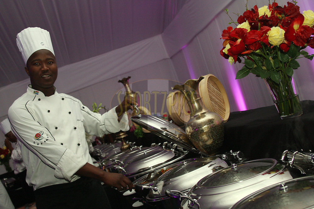 One of the chefs serving the buffet during the Prizegiving Dinner of the Sanlam Cancer Challenge Finals held at The Gary Player Country Club in Sun City near Johannesburg on the 22nd October 2013. Photo by Jacques Rossouw - SPORTZPICS