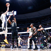 01 April 2018: Denver Nuggets guard Jamal Murray (27) passes the ball over Milwaukee Bucks guard Eric Bledsoe (6) during the Denver Nuggets 128-125 victory over the Milwaukee Bucks, at the Pepsi Center, Denver, Colorado, USA.