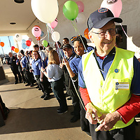 Adam Robison | BUY AT PHOTOS.DJOURNAL.COM<br /> Walter Turner, a courtesy clerk at Kroger, stand with his co-workers as they wait together for the ribbon cutting and grand reopening to begin at Kroger on Main Street in Tupelo Wednesday morning.