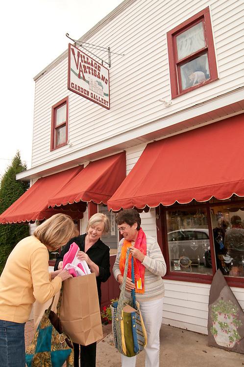 Shopping at Village Artisans Garden Gallery in Garden Michigan.