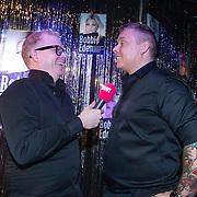 NLD/Amsterdam/20140325 - Boekpresentatie Bobbi Eden, DJ Tony Star, Tony Wyczynski word geinterviewd door Jan Roos van Powned